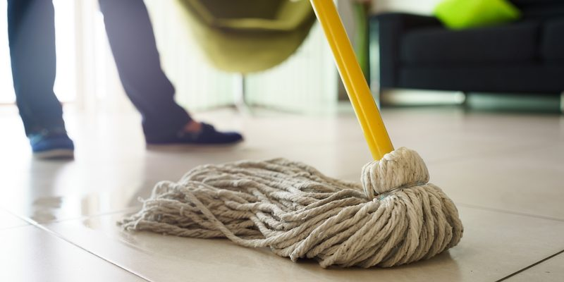Woman Doing Chores Cleaning Floor